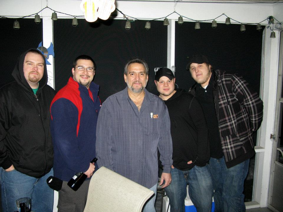 Dad was one of the fellas. We'd always hang out on his porch on Christmas eve. Here he is with my brother and I (left) and his two son-in-laws, which he considered his boys as well.