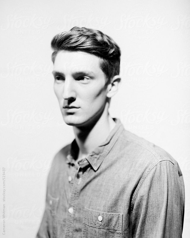 Young man studio portrait  by Cameron Whitman