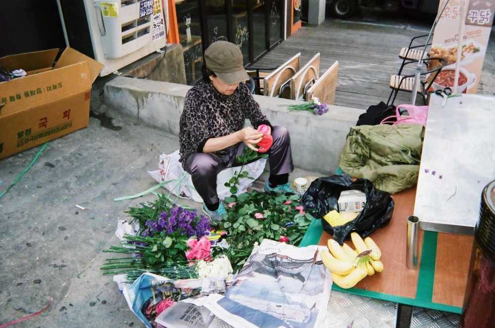 Prepping flowers for sale on the streets of Seoul