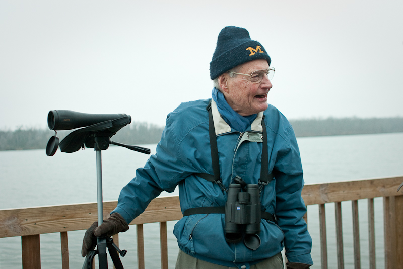 Local birding legend Doug James warms the mood of a bitter cold morning with a joke.