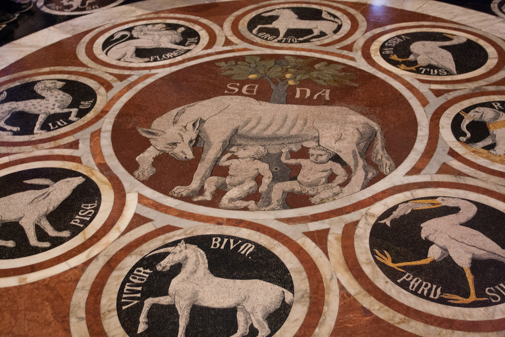 "Etched marble floors, ""The She-Wolf of Siena"" with the emblems of the confederate cities dates from approximately 1373."