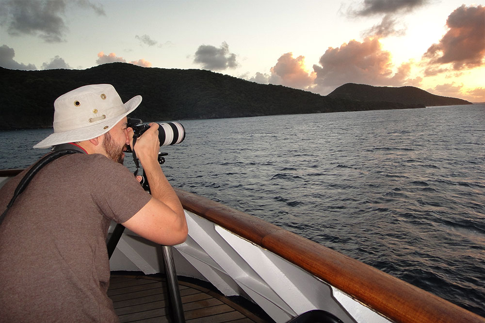 Photographing the last sunset of 2013 over the Caribbean.