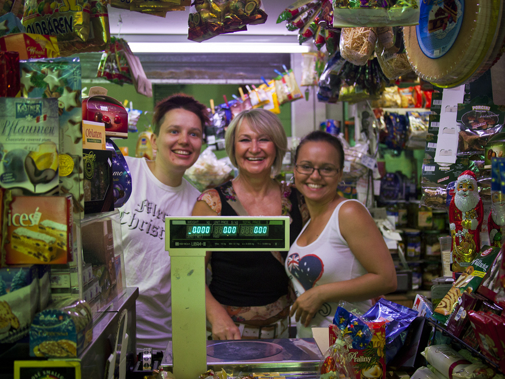 Valdec's rriendly staff serving customers between shelves piled high with exotic looking goods
