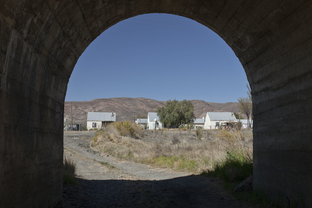 Outlying houses through the railway tunnel
