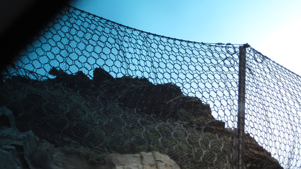 Boulder nets protecting the roadway