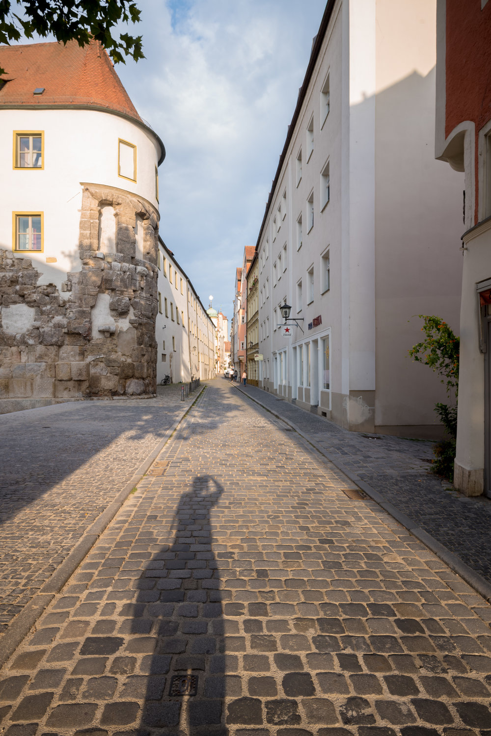 Regensburg, Germany  The large stones embedded in the building on the left are the remains of  Porta Praetoria , a gate into the Roman town of Castra Regina, was built in AD 179 by Emperor Marcus Aurelius.