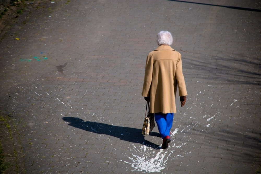 Woman walking from the Fountain in Londonderry