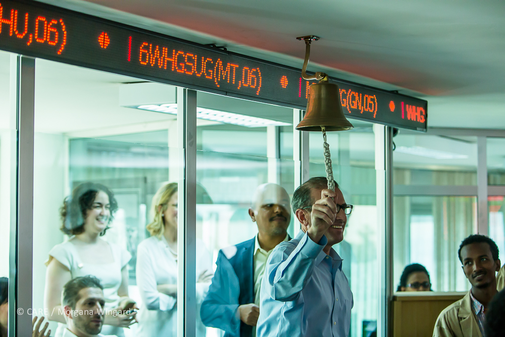 Addis Ababa, Ethiopia - Jan 23, 2014:  Rob Lehman, Chief of Staff for Senator Rob Portman (OH) rings the bell for the Ethiopia Commodity Exchange trading floor.