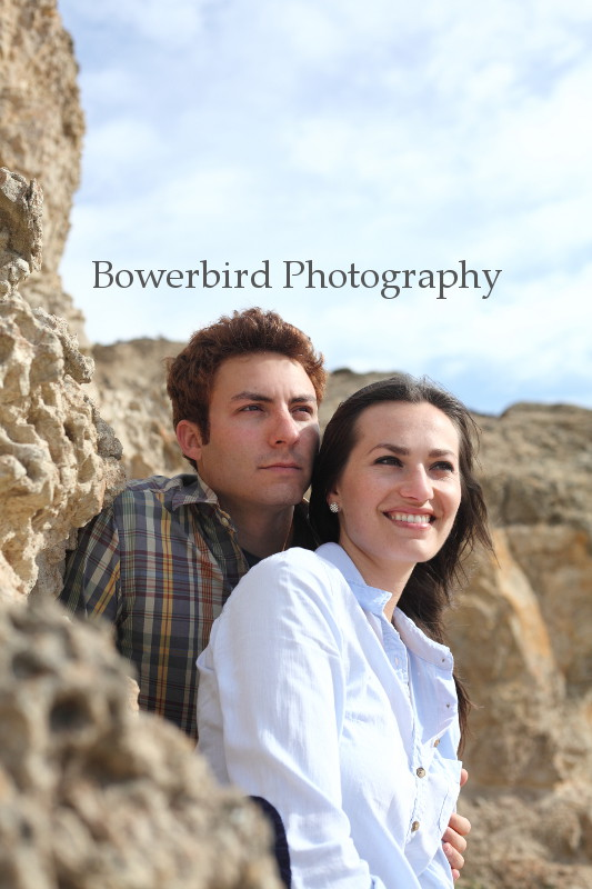 Nick and Sara look out over the Bay and the Sutro Baths.  © Bowerbird Photography 2012; Engagement Photography at Lands End, San Francisco.