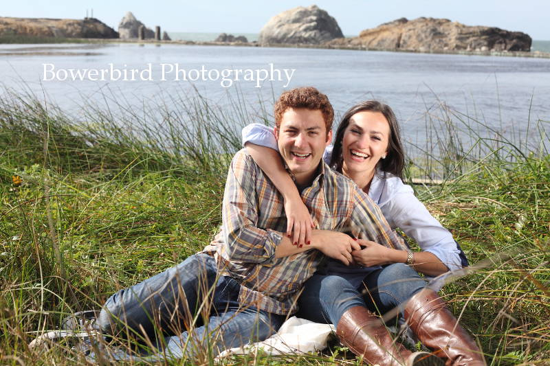 Snuggling among the reeds with a backdrop of the Bay.  © Bowerbird Photography 2012; Engagement Photography at Lands End, San Francisco.