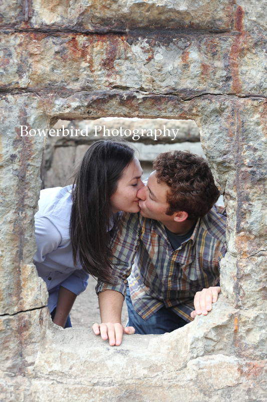 Sharing a kiss.  © Bowerbird Photography 2012; Engagement Photography at Lands End, San Francisco.