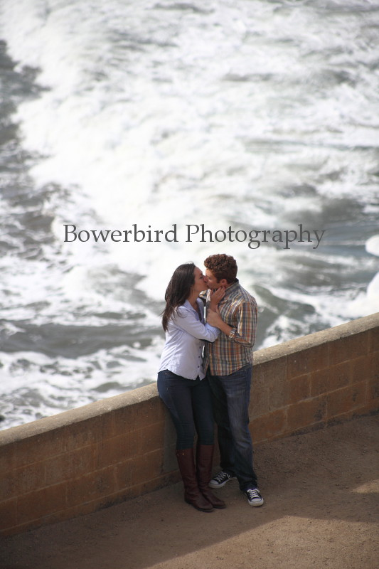The waves crash below, but all that exists for them is each other. © Bowerbird Photography 2012; Engagement Photography at Lands End, San Francisco.
