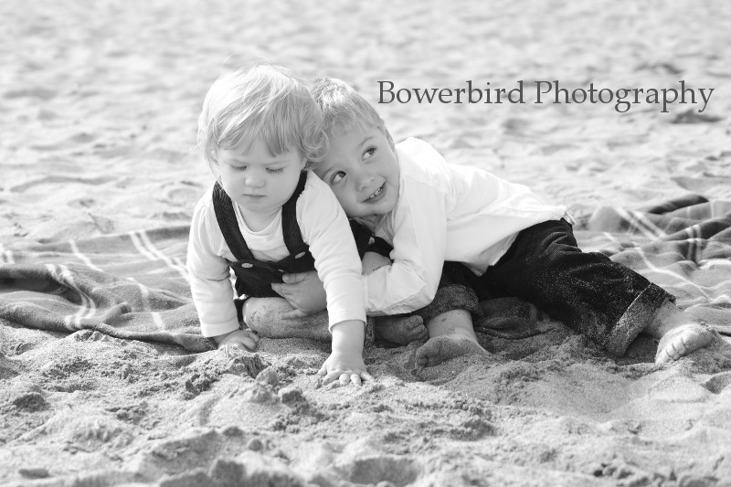 Giving hugs in the sand. © Bowerbird Photography 2012; Family Photography at Crissy Field, San Francisco.