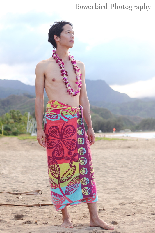 After a run and a swim, Ariel decorates me with an orchid lei.  © Bowerbird Photography 2012; Orchid lei, Kauaii, Hawaii