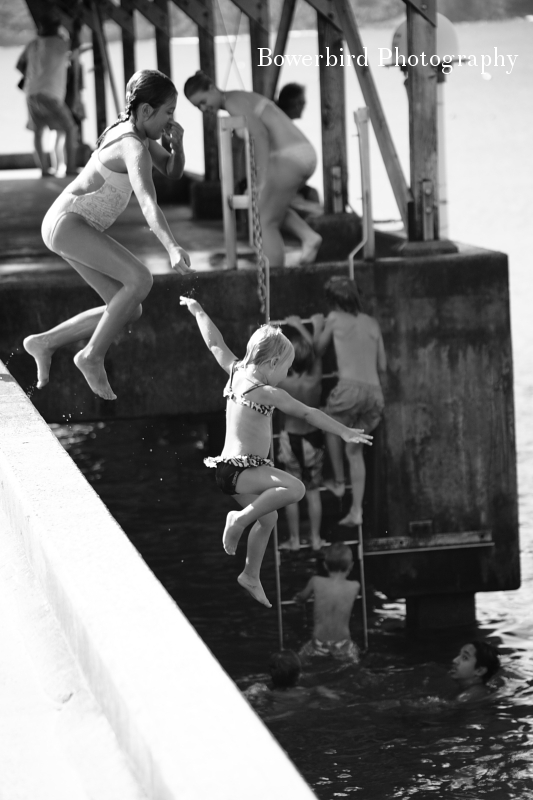 Kiddos jumping off the Hanalei Bay Pier.© Bowerbird Photography 2012; Travel Photography Kauai, Hawaii.