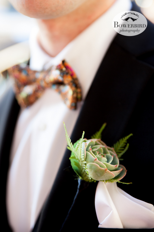 The groom looks dashing, with a custom bow-tie, succulent boutonniere with the smallest ferns, and silk handkerchief.  © Bowerbird Photography 2013; Mark Hopkins Hotel, San Francisco.