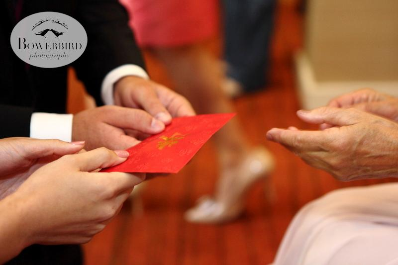 The morning started with a traditional Chinese tea ceremony, where the bride and groom were given little red envelopes. © Bowerbird Photography 2013; St. Ignatius Church Wedding, San Francisco.