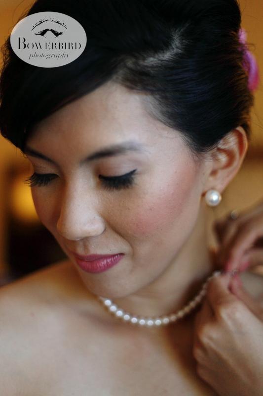 The bride in her wedding pearls. ©Bowerbird Photography 2013; St. Ignatius Church Wedding, San Francisco.