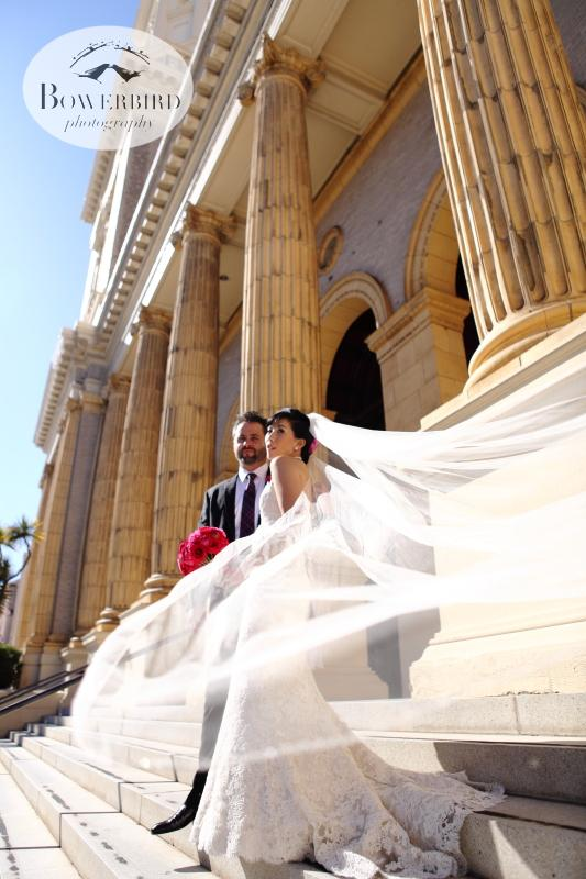 The brides veil plays in the breeze. © Bowerbird Photography 2013; St. Ignatius Church Wedding, San Francisco.