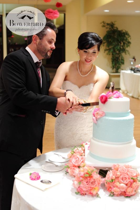 The bride and groom cutting their elegant wedding cake. © Bowerbird Photography 2013; Marin Art and Garden Center Wedding, Ross, CA.