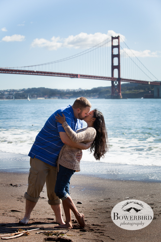 A serious kiss, with the Golden Gate Bridge in the background. © Bowerbird Photography 2013; Engagement Photography at Kirby Cove, Marin.