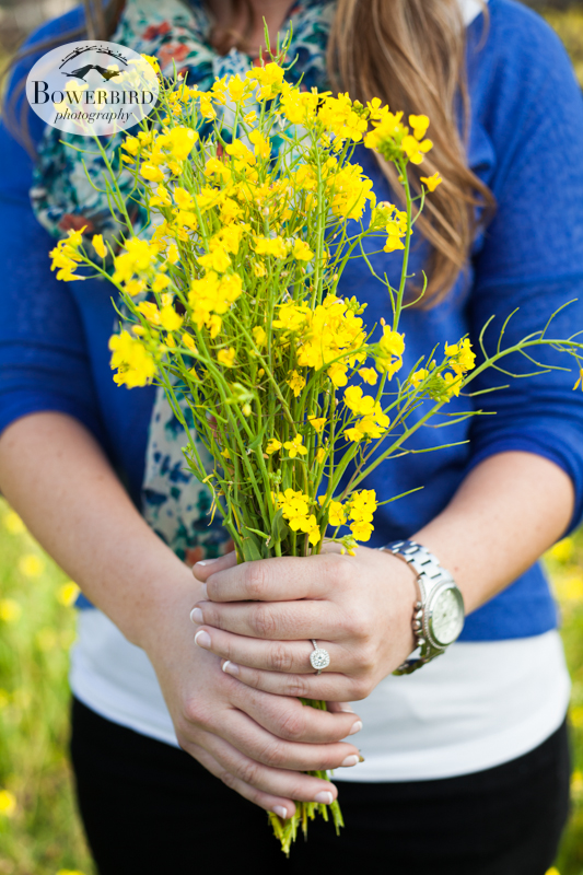Julia with a bouquet of wild mustard flowers. ©  Bowerbird Photography 2013; Engagement Photography in Napa Valley, CA.