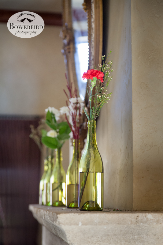 Pretty flower arrangements in wine bottles. © Bowerbird Photography 2013, Clos LaChance Winery in San Martin, Wedding Site Visit.