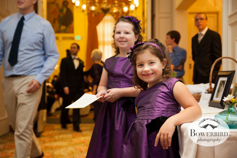 Anastasia's cousins help pass out programs. © Bowerbird Photography 2013; Mark Hopkins Hotel Wedding, San Francisco.