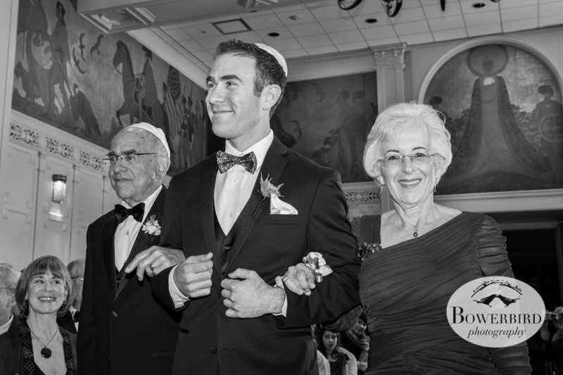 Matt, beaming down the aisle, with his proud parents. © Bowerbird Photography 2013; Mark Hopkins Hotel Wedding, San Francisco.