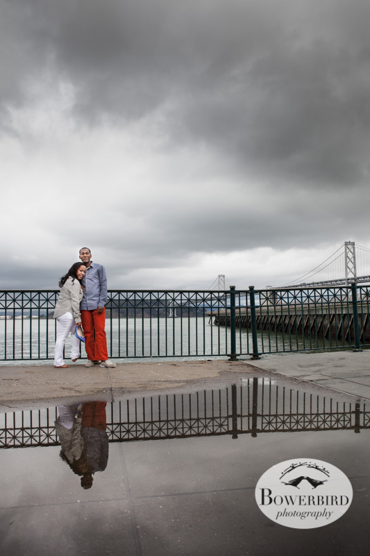 A reflection of the lovely couple. © Bowerbird Photography 2013; San Francisco,Bay Bridge Engagement Photo.