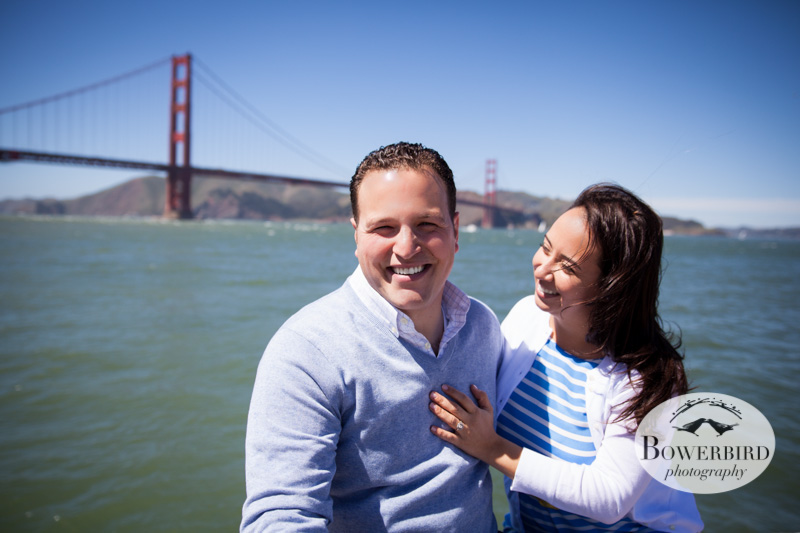 Sitting on the dock by the Golden Gate Bridge. © Bowerbird Photography 2013; San Francisco Engagement Photo.