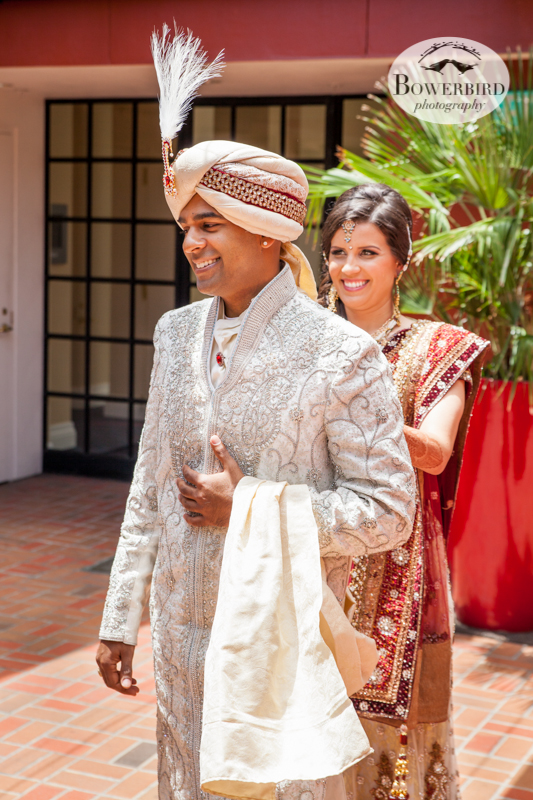 The bride taps the groom's shoulder, and he turns around to see her for the first look. © Bowerbird Photography 2013, First Look, South Asian Wedding at the San Francisco JW Marriott and Winery SF on Treasure Island.