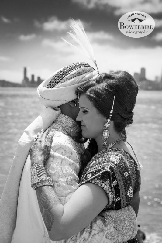 When the wind picked up, the bride and groom held each other to keep warm. © Bowerbird Photography 2013, View of San Francisco from Treasure Island, South Asian Wedding at the Winery SF on Treasure Island.