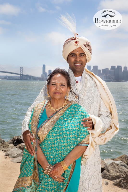 The groom and his mom, with the Bay Bridge in the background. © Bowerbird Photography 2013, Family Photos on Treasure Island, South Asian Wedding at the Winery SF on Treasure Island.