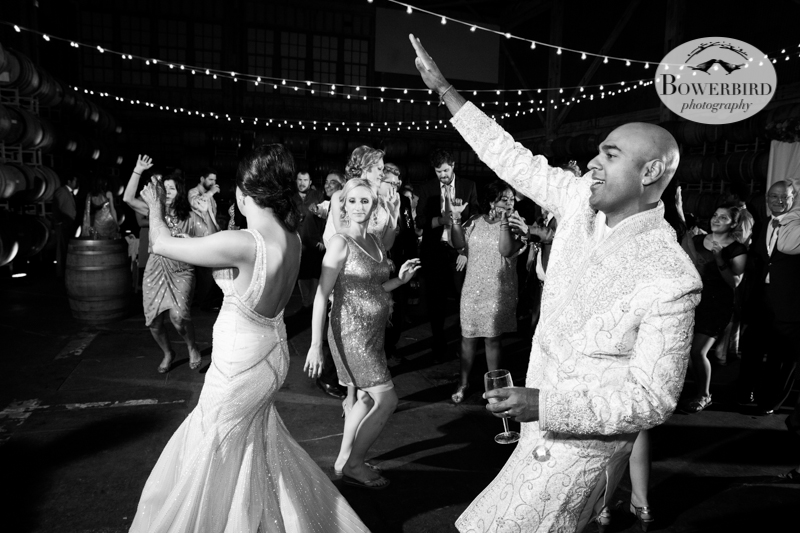 The bride and groom get their groove on! © Bowerbird Photography 2013, Wedding at the San Francisco Winery SF on Treasure Island.
