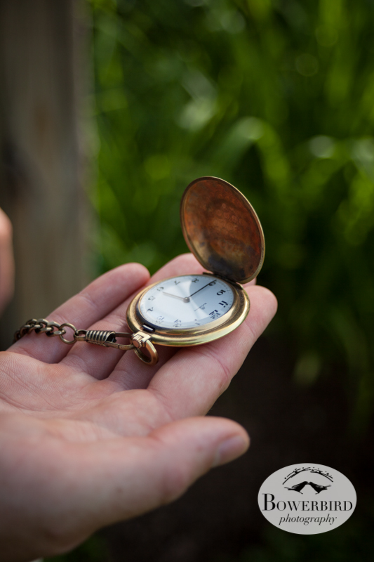 The groom looking at his pocket watch, a gift from his bride. © Bowerbird Photography 2013, Destination Wedding Photography in the Brandywine Valley, Pennsylvania.