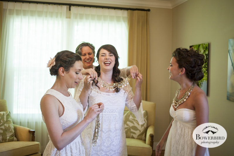The gals help each other get dressed, wearing fab necklaces that coordinated so well with their dresses. (Kunde Family Estate Wedding Photography in Kenwood. © Bowerbird Photography 2014)