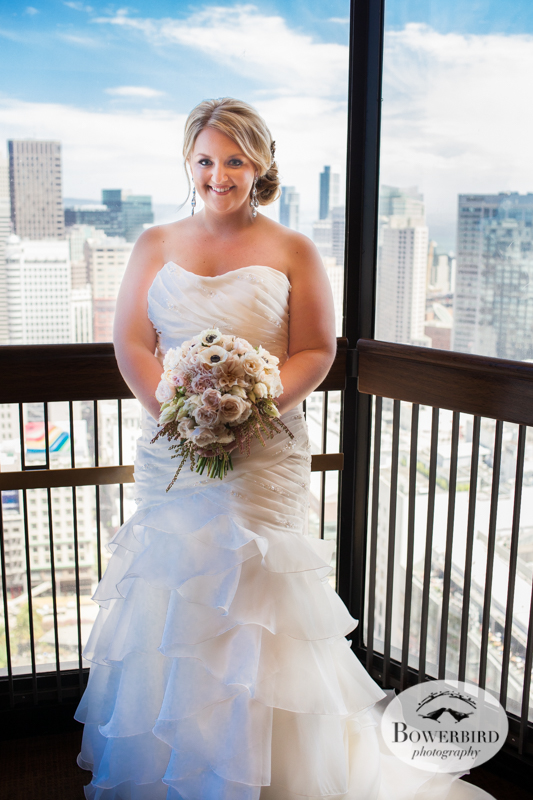 The bride rides the escalator up to see her groom. Westin St. Francis Hotel SF Wedding © 2014 Bowerbird Photography