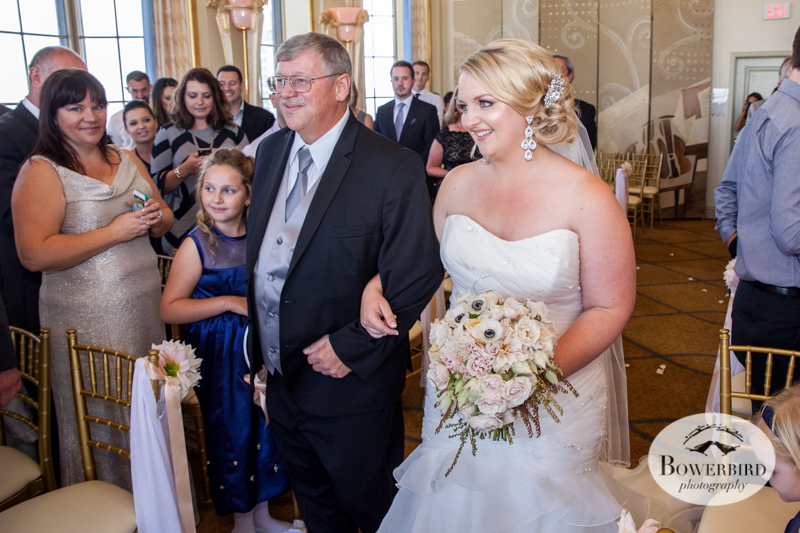 The bride walks down the aisle with her dad. Westin St. Francis wedding ceremony on Imperial Floor. © 2014 Bowerbird Photography