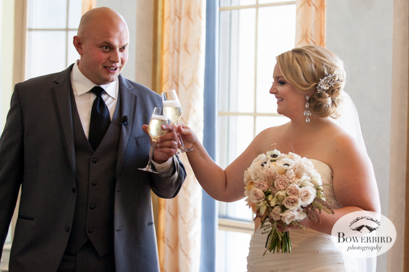 Moments after the ceremony, the couple celebrates with champagne. © Bowerbird Photography 2014
