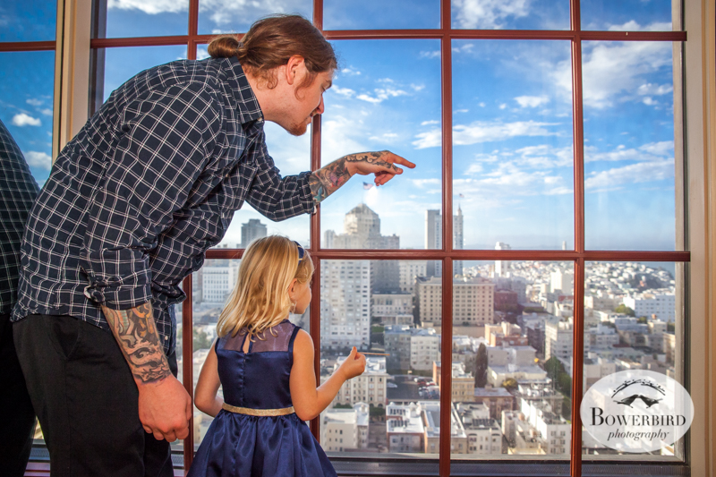 A flower girl enjoys the city view from atop the Westin St. Francis Hotel. © Bowerbird Photography 2014