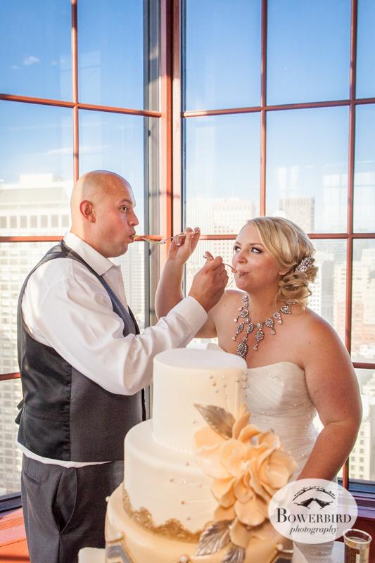 Bride and groom taste their wedding cake. Westin St. Francis Wedding © Bowerbird Photography 2014