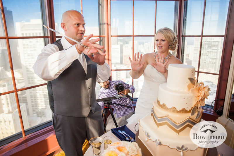 The groom shows off his cake cutting skills. Westin St. Francis Wedding in SF © Bowerbird Photography 2014