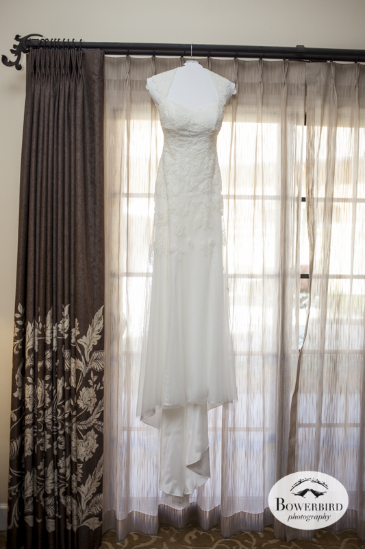 Her wedding dress hangs ready to wear. © Bowerbird Photography 2014