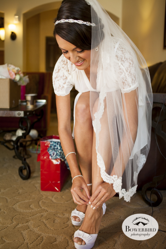 The bride puts on her shoes. Meritage Resort & Spa.© Bowerbird Photography 2014