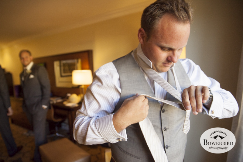 The groom prepares in his room at the Meritage Resort & Spa. © Bowerbird Photography 2014