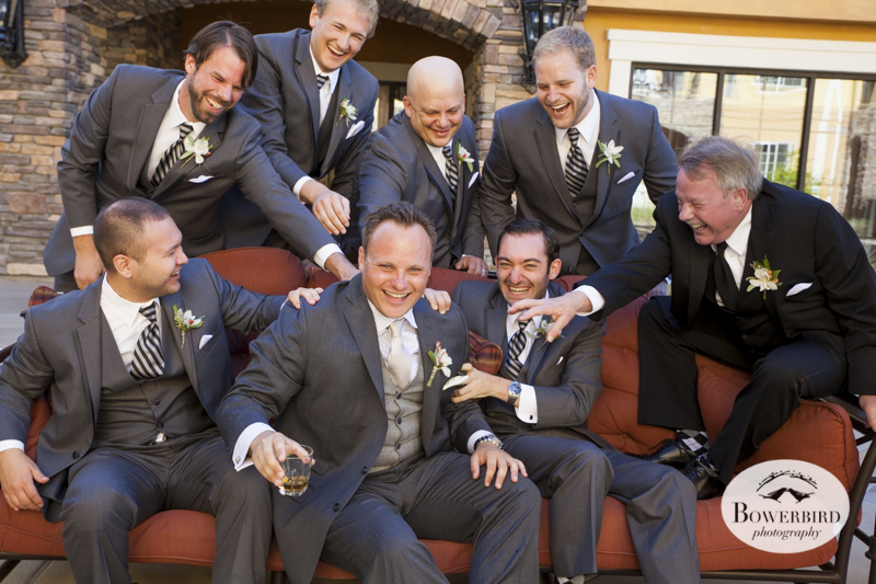 There's no chance these guys will let the groom sip his drink in peace. So much excitement on the big day. © Bowerbird Photography 2014