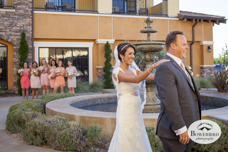 The bridesmaids look on as the bride greets her groom. One of our favorite wedding photos from their big day at the Meritage Resort & Spa in Napa Valley.© Bowerbird Photography 2014