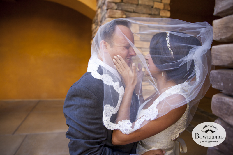 That's what the veil is for! The bride and groom share a moment before the ceremony. Meritage Resort & Spa.© Bowerbird Photography 2014