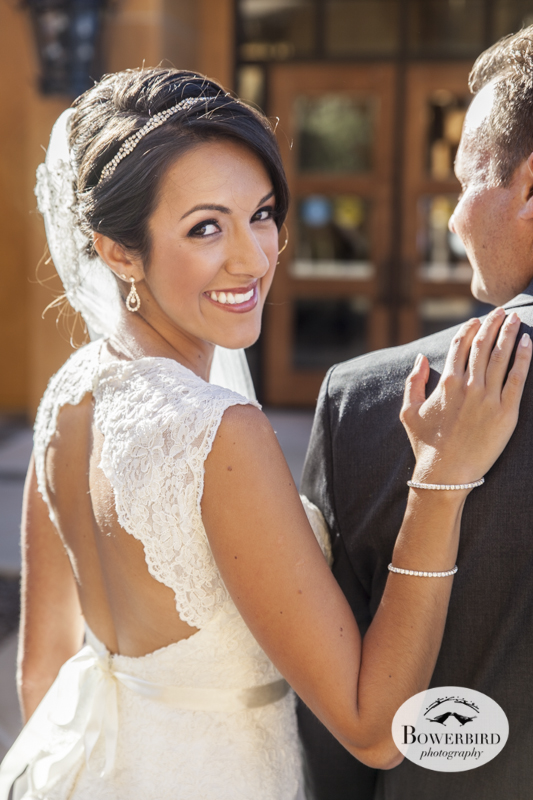 The bride looks incredible in her backless wedding dress. Meritage Resort & Spa.© Bowerbird Photography 2014